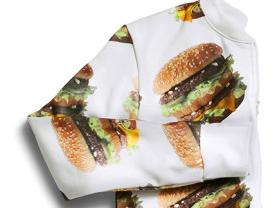 The new McDelivery Collection, a new clothing line that includes an adult-size Big Mac onesie.