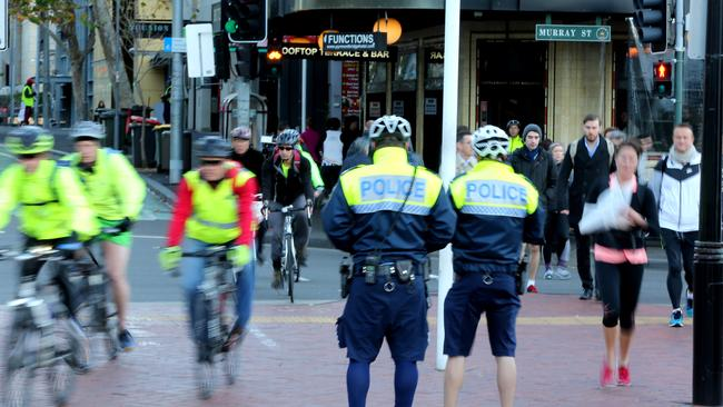 Police warning and booking people at Darling Harbour during Operation Pedro 5. Picture: Stephen Cooper