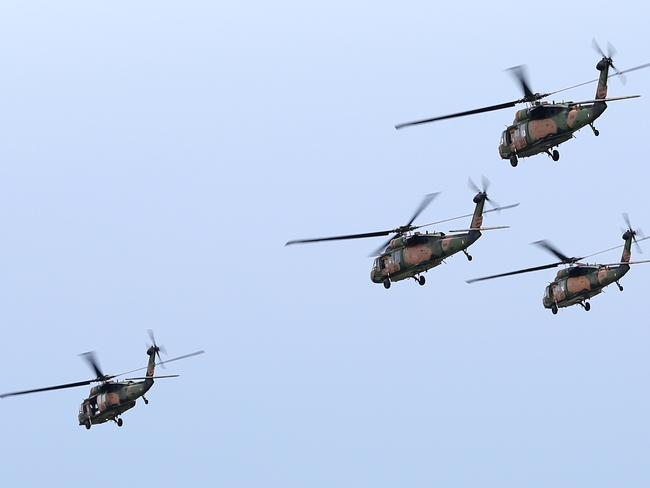 Black Hawk helicopters fly in support of a Maritime Counter Terrorist exercise in Victoria.