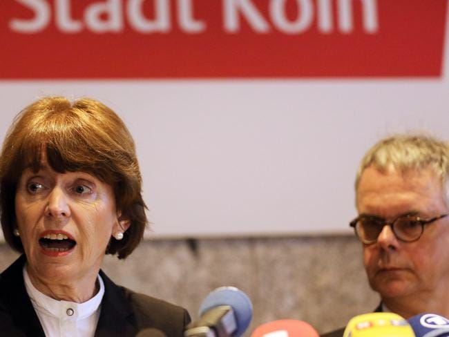 Cologne mayor Henriette Reker, left, and the head of Cologne police, Wolfgang Albers, attend a news conference in Cologne, in response to the mass attacks.