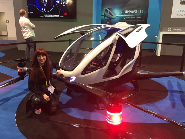 Shara Evans with the Ehang 184 autonomous personal flying vehicle at the Consumer Electronics Show.