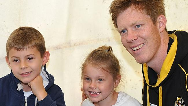 Riewoldt poses for a photo with fans at the Richmond family day this year. (Photo by Vince Caligiuri