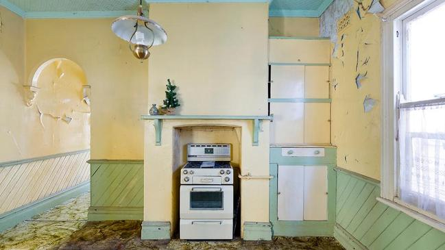 """The paint was peeling and the """"kitchen"""" was bare."""