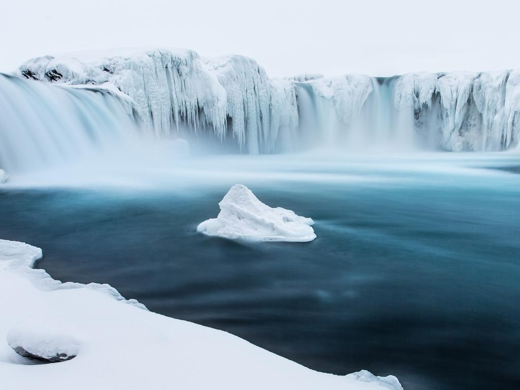 """The is the famous Goðafoss in wintertime, Iceland. Clear blue/green water and ice everywhere."" Picture: Markus van Hauten, Germany, Shortlist, Open Panoramic, 2016 Sony World Photography Awards"