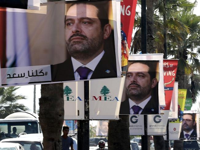 Posters of former Lebanese Prime Minister Saad Hariri hang in Beirut with a caption reading below in Arabic 'We are all Saad'. Picture: AFP