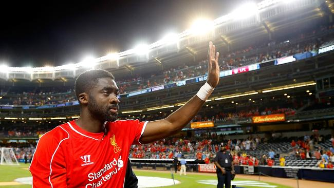 Kolo Toure #4 of Liverpool waves to the crowd.