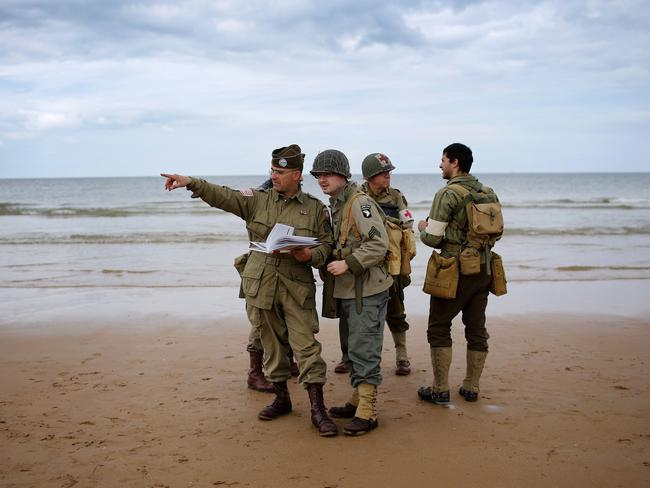 World War II re-enactors practice for the 70th anniversary of D-day on Omaha Beach. Picture: Christopher Furlong/Getty Images