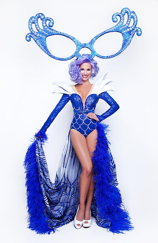 The outfit is a nod to dame edna and the sydney opera house picture