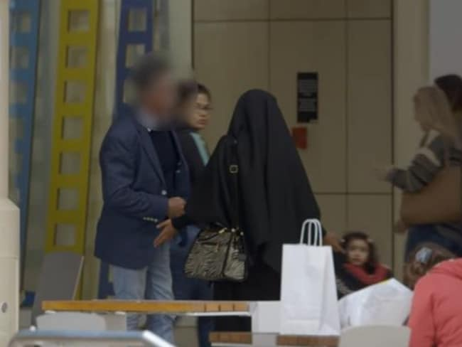 Rahila is shocked as the man confronts her in front of several people. Picture: Screengrab/SBS