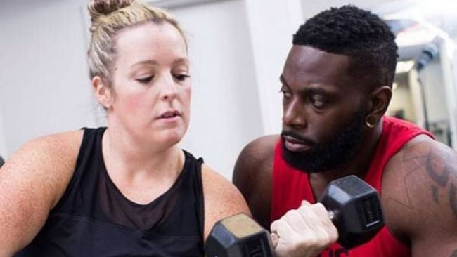 Hill and his client, Alyssa, working out together on the show.
