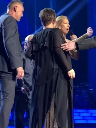 Celine tells security to back off.