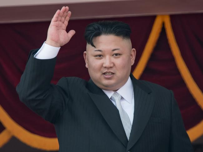 North Korean leader Kim Jong-Un waving from a balcony of the Grand People's Study house. Picture: AFP