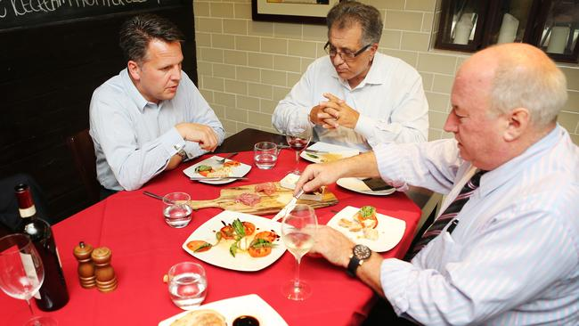 Let's do lunch... Journalist James McCullough (right) with Qantas State Manager Peter Collins and restaurant owner Con Sciacca at Adelaide Street restaurant Alimentari. Picture: Tara Croser.