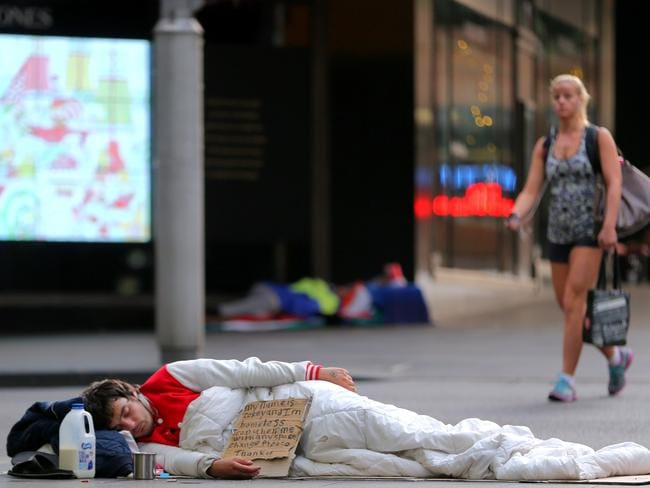 A homeless man sleeping on the corner of Market St and castlereagh St in Sydney's CBD. Pic: John Grainger