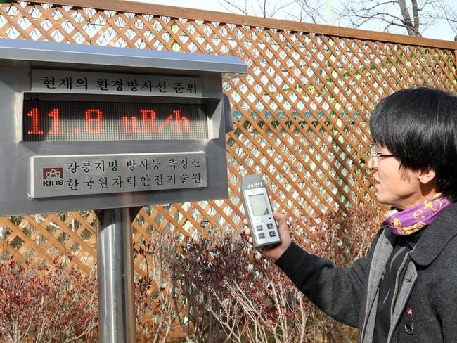 A lab employee from the Korea Institute of Nuclear Safety's regional office in Gangneung, east of Seoul, checks for radioactive traces in the air soon after North Korea's hydrogen bomb test. Picture: AAP