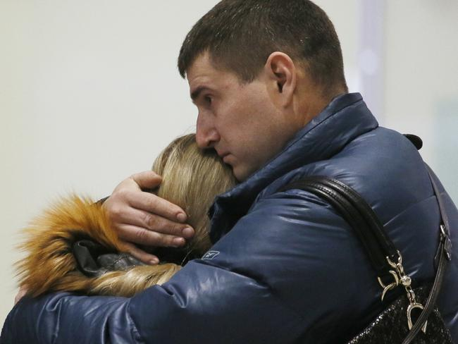 Grief ... Relatives react after a Russian airliner with 217 passengers and seven crew aboard crashed, as people gather at Russian airline Kogalymavia's information desk at Pulkovo airport in St. Petersburg. Picture: Dmitry Lovetsky/AP Photo