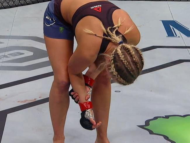 Paige VanZant holds her right arm after the final bell.