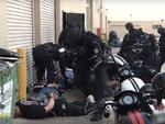 A Raptor raid on the Nomads clubhouse in Sydney saw the whole chapter lined up outside the premises and put on their stomachs.