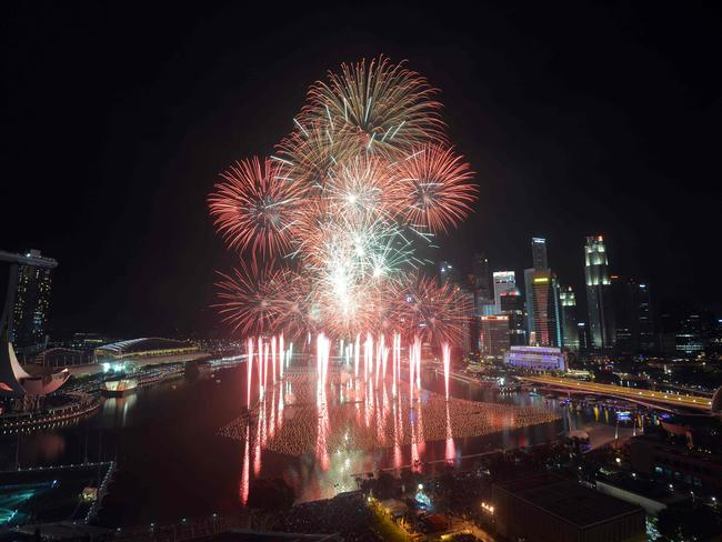 Big display ... fireworks explode over the Marina Bay in Singapore. Picture: AFP/Mohd Fyrol