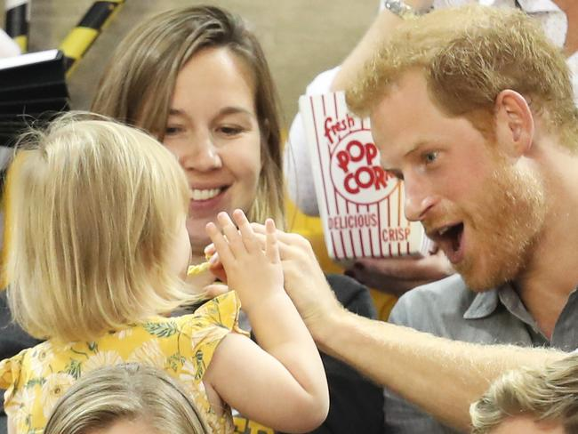 ... but he gives in and shares some with his new little mate. Picture: Chris Jackson/Getty Images for the Invictus Games Foundation