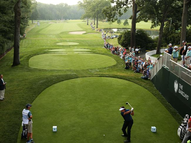 Phil Mickelson plays his shot from the first tee during the first round of The Barclays.