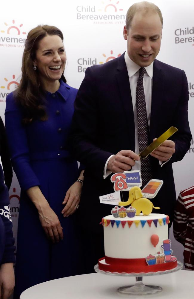 The royal couple cut a cake to celebrate the first anniversary of the charity's branch. Picture: Matt Dunham.