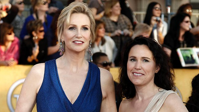 "Jane Lynch, left, and Lara Embry said splitting up was ""a difficult decision for us as we care very deeply about one another."""