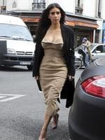 Spot of shopping before the big day ... Kim Kardashian arrives at a shop in Paris on May 21. The gates of the Chateau de Versailles, once the digs of Louis XIV, will be thrown open to Kim Kardashian, Kanye West and their guests for a private evening this week ahead of their marriage. Picture: AFP