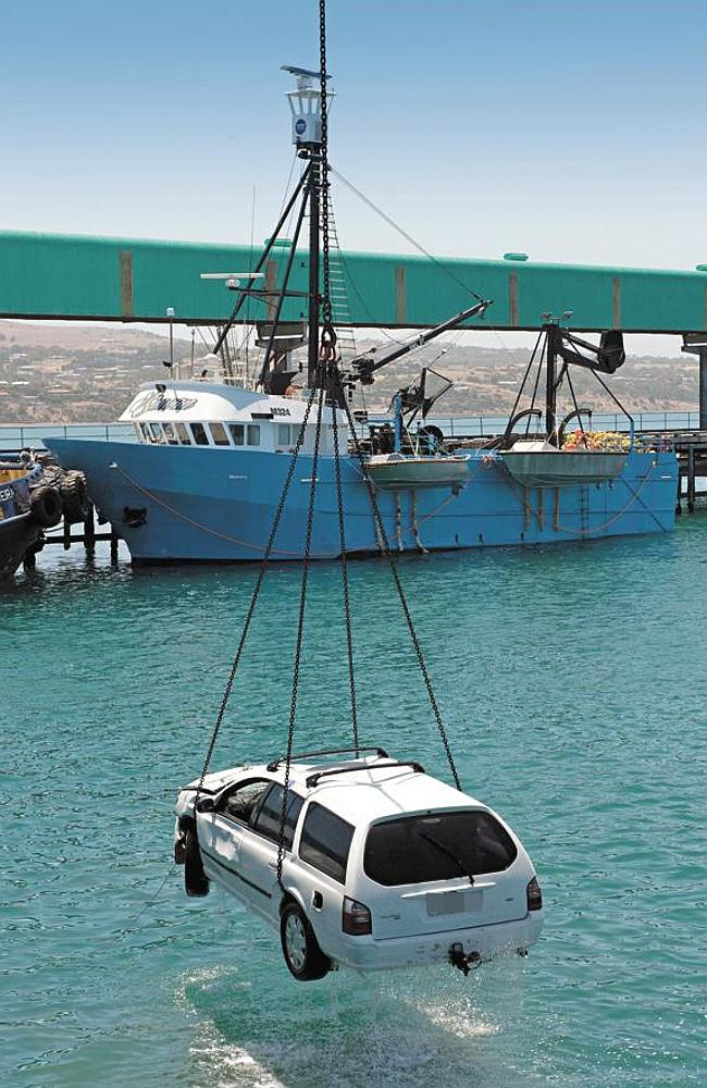 The Ford Falcon is lifted from the water at Port Lincoln. Picture: Ivon Perrin