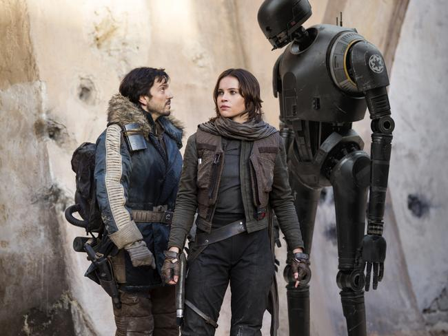 Scene from film Rogue One: A Star Wars Story L to R: Cassian Andor (played by Diego Luna), Jyn Erso (Felicity Jones) and K-2SO (Alan Tudyk). Picture: Lucasfilm Ltd.