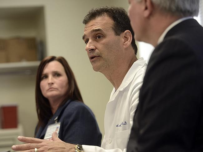'Significant injuries' ... Forbes Hospital's Dr. Mark Rubino, center, addresses the media.
