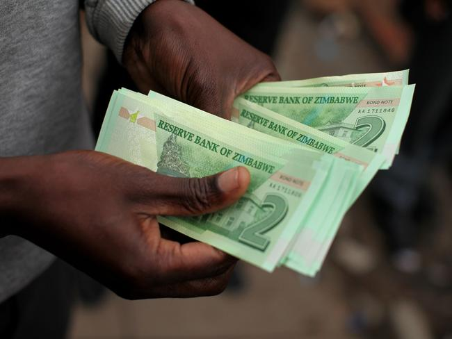 Introduced 12 months ago, Zimbabwe's bond notes have sparked a multi-tier pricing structure. Picture: AFP/Wilfred Kajese