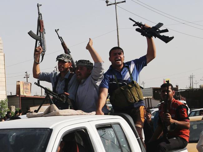 Call to arms ... Iraqi Shiite fighters deploy with their weapons in Basra, Iraq's second-largest city. Picture: Nabil Al-Jurani