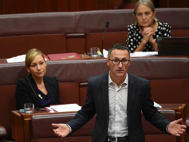 Look at those long faces … Greens leader Senator Richard Di Natale speaks on an amendment to the government's senate electoral reforms. Pictures: AAP Image/Mick Tsikas