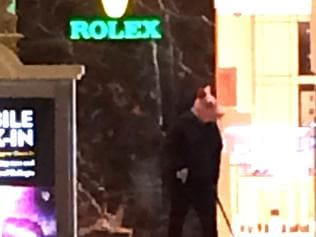 Picture from twitter. Kira‏ @Kir_kamil 2h More Literally just witnessed an armed robber in a pig mask at a Rolex store at the Bellagio & then his arrest #bellagio #vegas #rolex #robbery pic.twitter.com/m53T6bHS2z