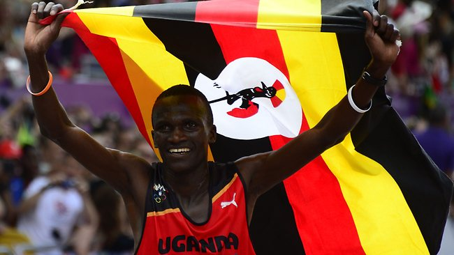 Uganda's Stephen Kiprotich waves his national flag as he celebrates winning the men's marathon.