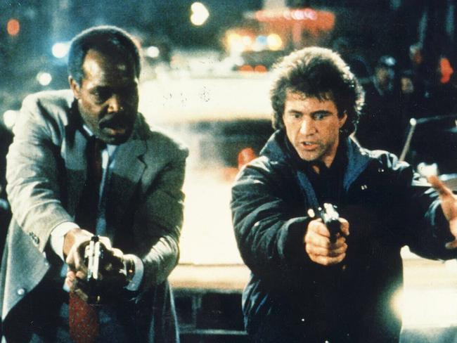 Oh the mullet and the mo ... Danny Glover and Mel Gibson rock 1980s fashion.
