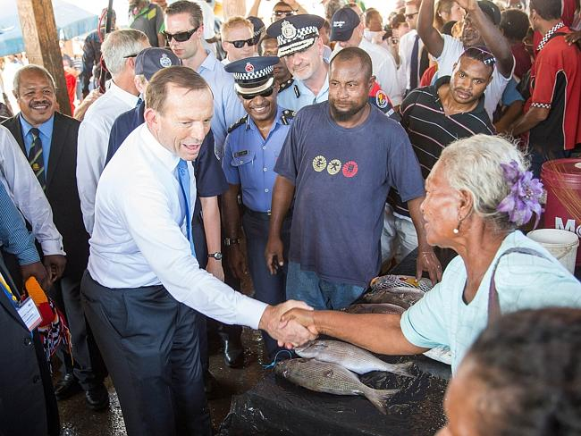 Given rousing reception ... Australian Prime Minister Tony Abbott shakes hands with a loc