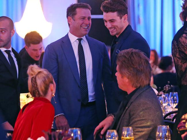 The pair mingle with Richard Wilkins and The Bachelor's Matty J after the parade.
