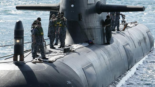 HMAS Waller, a Collins class sub. And some blokes. Pointing at something.