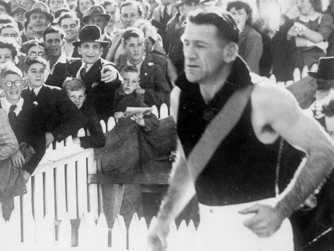 Famous 17 Jack Dyer leads the Tigers out for last time.
