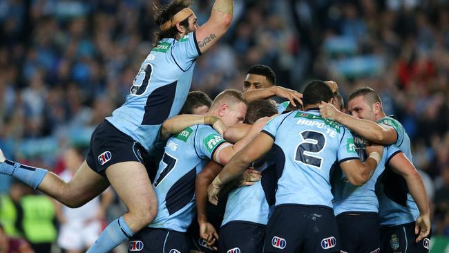 NSW's Trent Hodkinson scores and celebrates with the team.