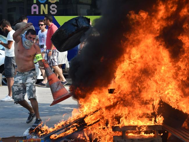 French Taxi drivers protest in Marseilles against UberPOP. Picture: AFP/ANNE-CHRISTINE POUJOULAT