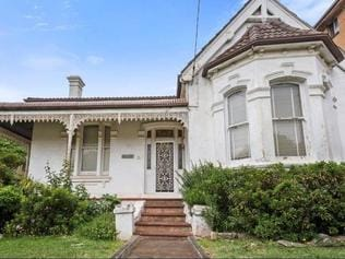This dilapidated 'time capsule' house at 5 George St Marrickville sold for $3.87m - $1/8m above its reserve - and will be bulldozed