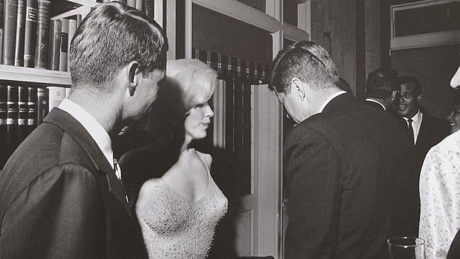 Marilyn Monroe with President John F. Kennedy, centre, and Robert Kennedy, left, at a Democratic fundraiser on May 19, 1962.