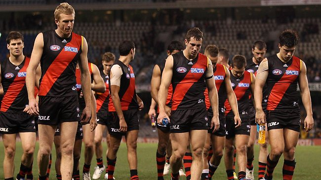 MELBOURNE, AUSTRALIA - JULY 27: Bomber players walk of the ground after the round 18 AFL match between the Essendon Bombers and the Hawthorn Hawks at Etihad Stadium on July 27, 2012 in Melbourne, Australia. (Photo by Lucas Dawson/Getty Images)