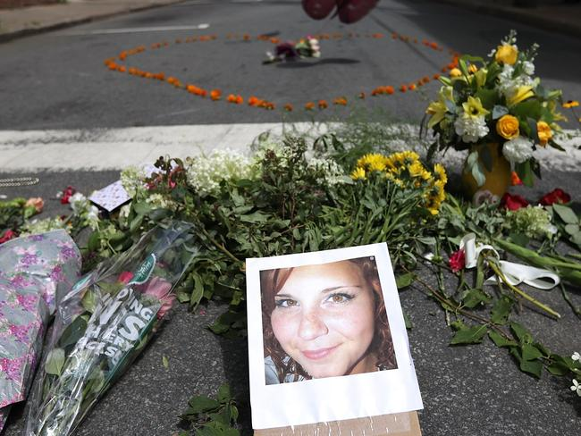 Flowers surround a photo of 32-year-old Heather Heyer, who was killed when a car ploughed into a crowd of people protesting against the white supremacist Unite the Right rally in Charlottesville, Virginia. Picture: Chip Somodevilla/Getty Images/AFP