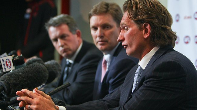 Essendon coach James Hird, along with chief executive Ian Robson and chairman David Evans, talk to the media about inappropriate use of supplements by some players at the club during the 2012 season. Picture: Chris Scott