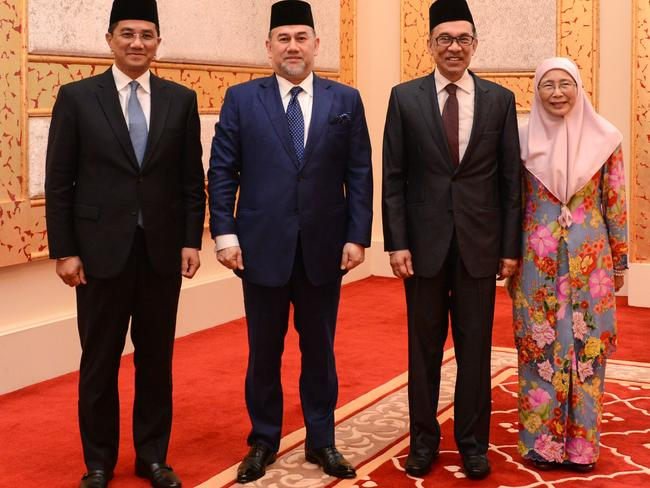 (from L to R) Selangor Chief Minister Mohamed Azmin Ali, Malaysia's King Muhammad V, former opposition leader and current federal opposition leader Anwar Ibrahim and Anwar's wife Wan Azizah. Picture: AFP