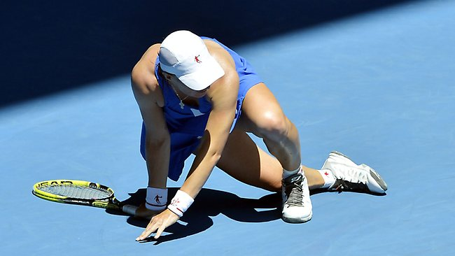 Svetlana Kuznetsova falls after rolling her ankle early in the second set against Victoria Azarenka. Picture: Jason Edwards